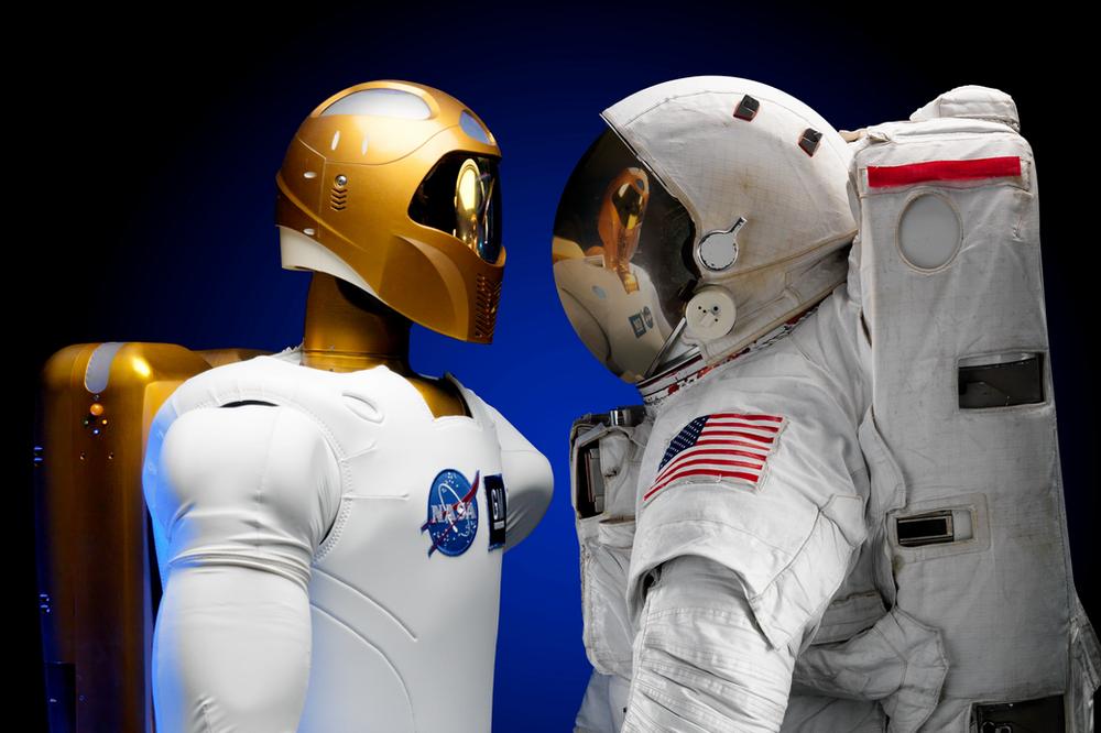 An astronaut looking at a robot version of an astronaut