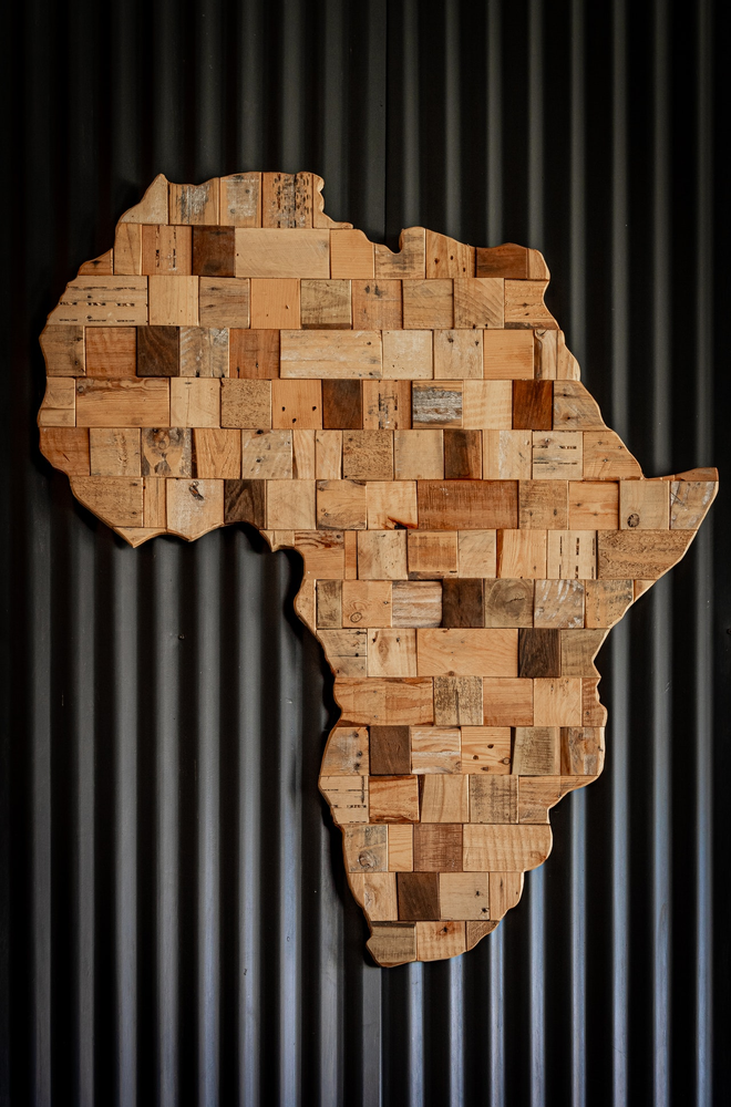 A wood carving piece art piece of the continent of Africa