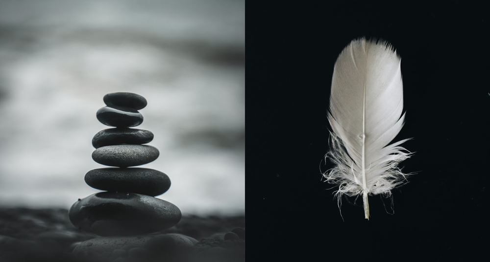 pebbles stacked on top of each other, and a feather