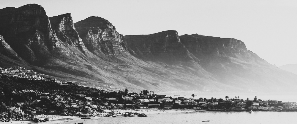 Photo of Cape Town showing houses and a mountain in the background